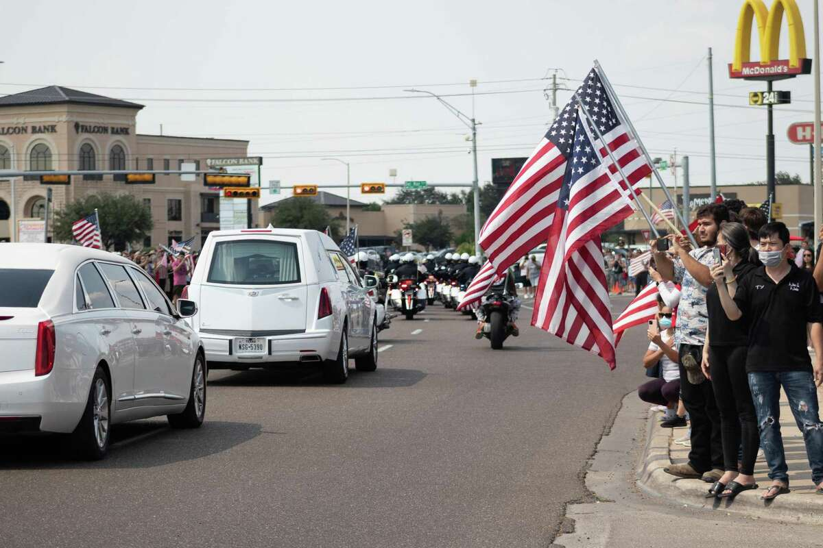 Crowds of Laredoans line up the streets of Del Mar Boulevard to honor Marine Lance Cpl. David Lee Espinoza on on Friday, Sept. 10, 2021.