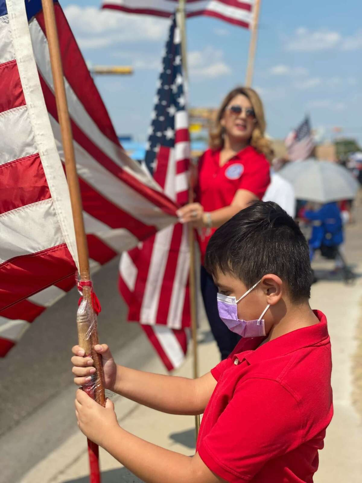 """Young boy Angel Contreras watched the procession and stated he will always """"remember this day"""" as he and others honored slain Laredo Marine Lance Cpl. David Lee Espinoza on Friday, Sept. 10, 2021."""