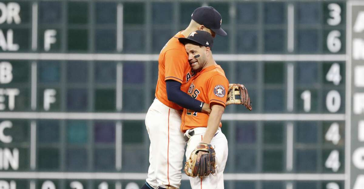 Houston Astros shortstop Carlos Correa (1) and Houston Astros second baseman Jose Altuve (27) hug after the Astros won 10-5 against the Los Angeles Angels during an MLB baseball game at Minute Maid Park, Friday, September 10, 2021, in Houston.