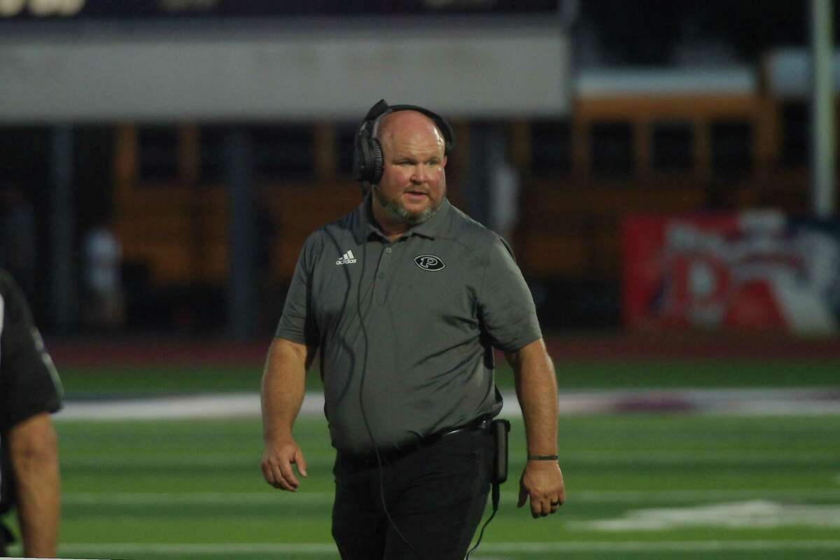 Pearland football coach Ricky Tullos watches as the Oilers play Conroe Oak Ridge Friday, Sep. 10, 2021 at The Rig.