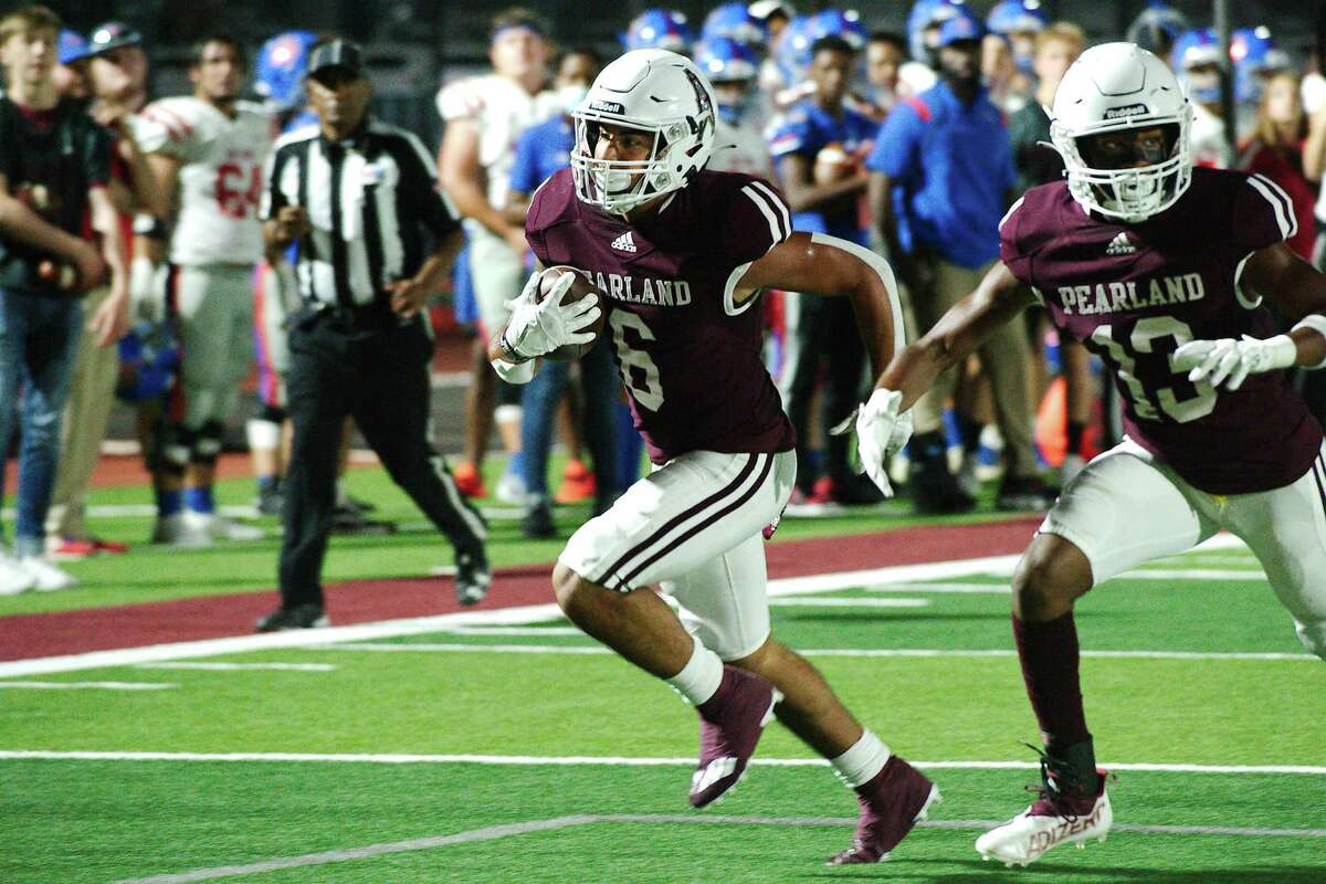 Pearland's Dominic Serna (6) sprints into the end zone behind the protection of Pearland's Aiden Glasper (13) Friday, Sep. 10, 2021 at The Rig.