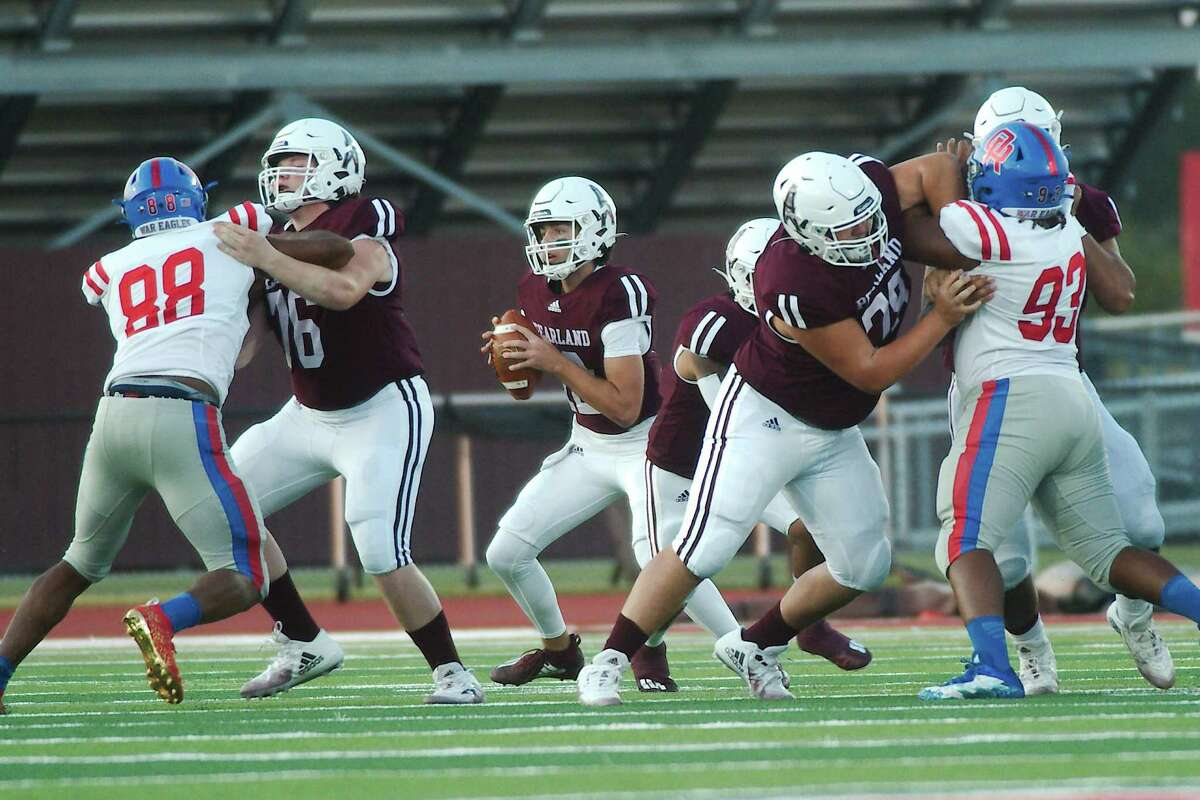 Pearland's Jake Sock (12) sets up to pass behind Pearland's Aidan Demmon (76) and Christian Argo (78) Friday, Sep. 10, 2021 at The Rig.