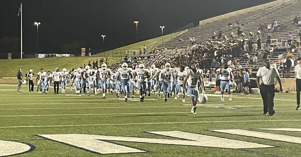 The Sam Rayburn Texans run triumphantly off the field following their 21-15 win over the Northbrook Raiders at Tully Stadium on Sept. 10 to give the Texans their first 3-0 start to a season since 2006.