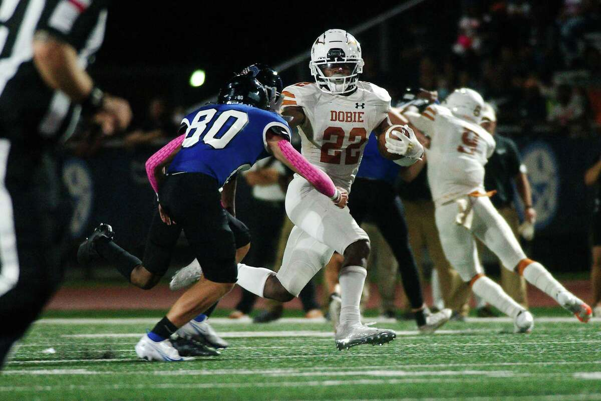 Dobie's Trahan Davis (22) is challenged by Friendswood's Landon Davis (80) Friday, Sep. 10, 2021 at Friendswood High School.