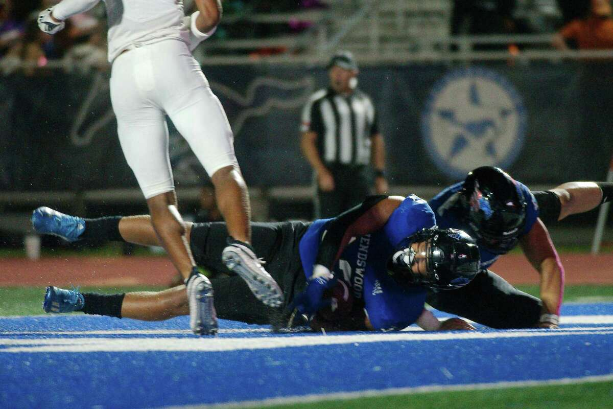 Friendswood's Caleb Corkran (33) and the rest of the Mustangs lost to Baytown Lee, 19-14, Friday night in Baytown.