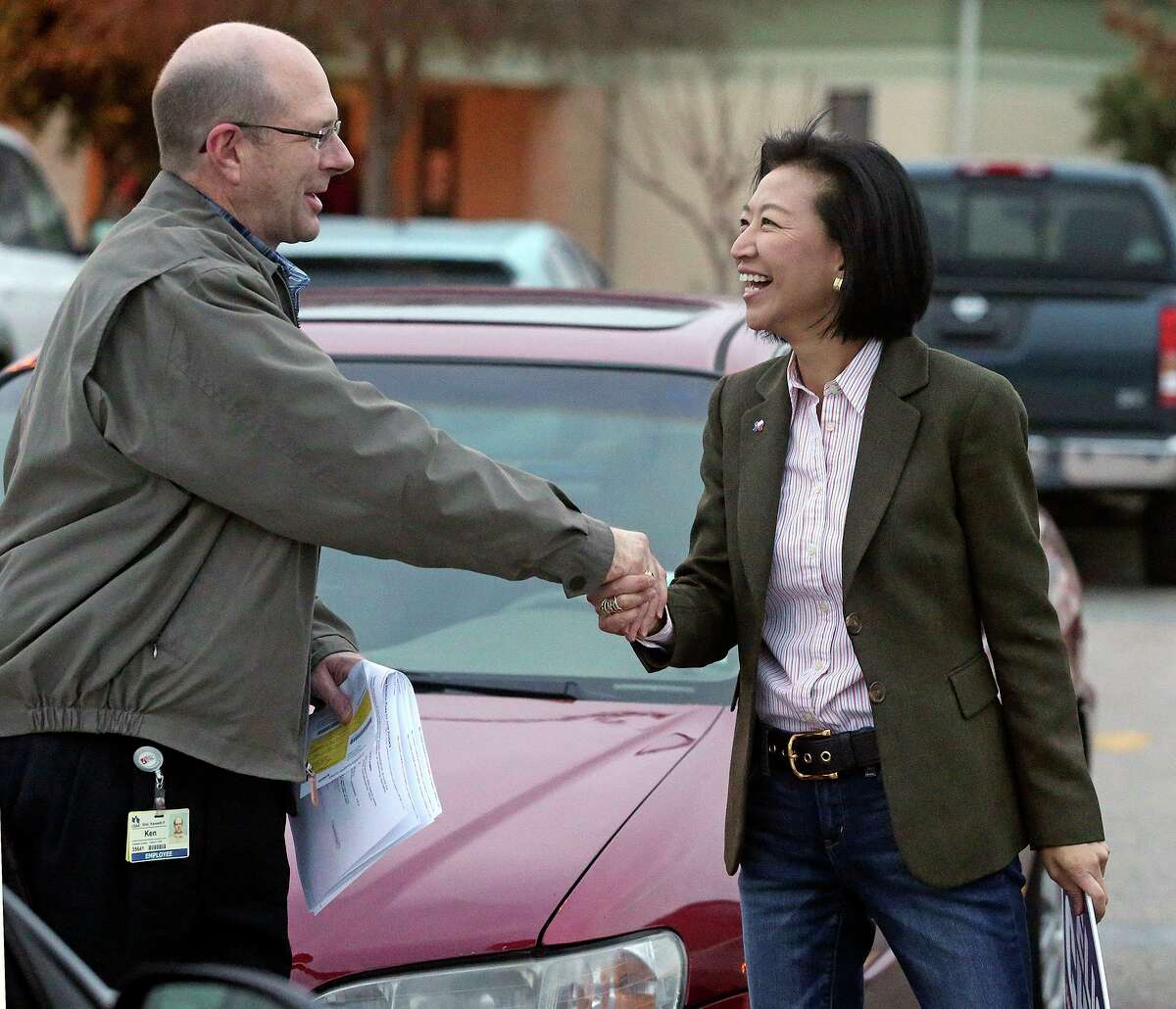 Elisa Chan thanks voter Ken Ebel at Barbara Bush Elementary School as she continues to work during voting on March 4, 2014, her last campaign. Chan said she is definitely running for District 122 if state Rep. Lyle Larson, as expected, steps aside.
