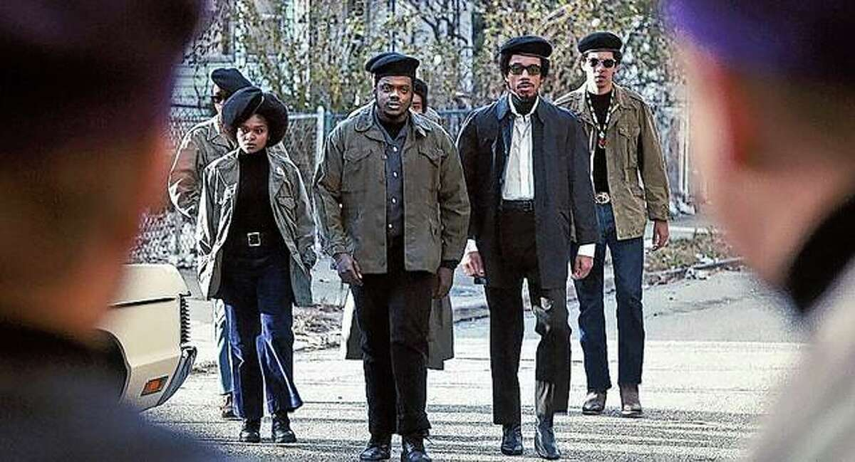 """Daniel Kaluuya (second from left) as Fred Hampton shares a scene with Dominque Thorne (from left), Darrell Britt-Gibson and Caleb Eberhardt in """"Judas and the Black Messiah""""."""