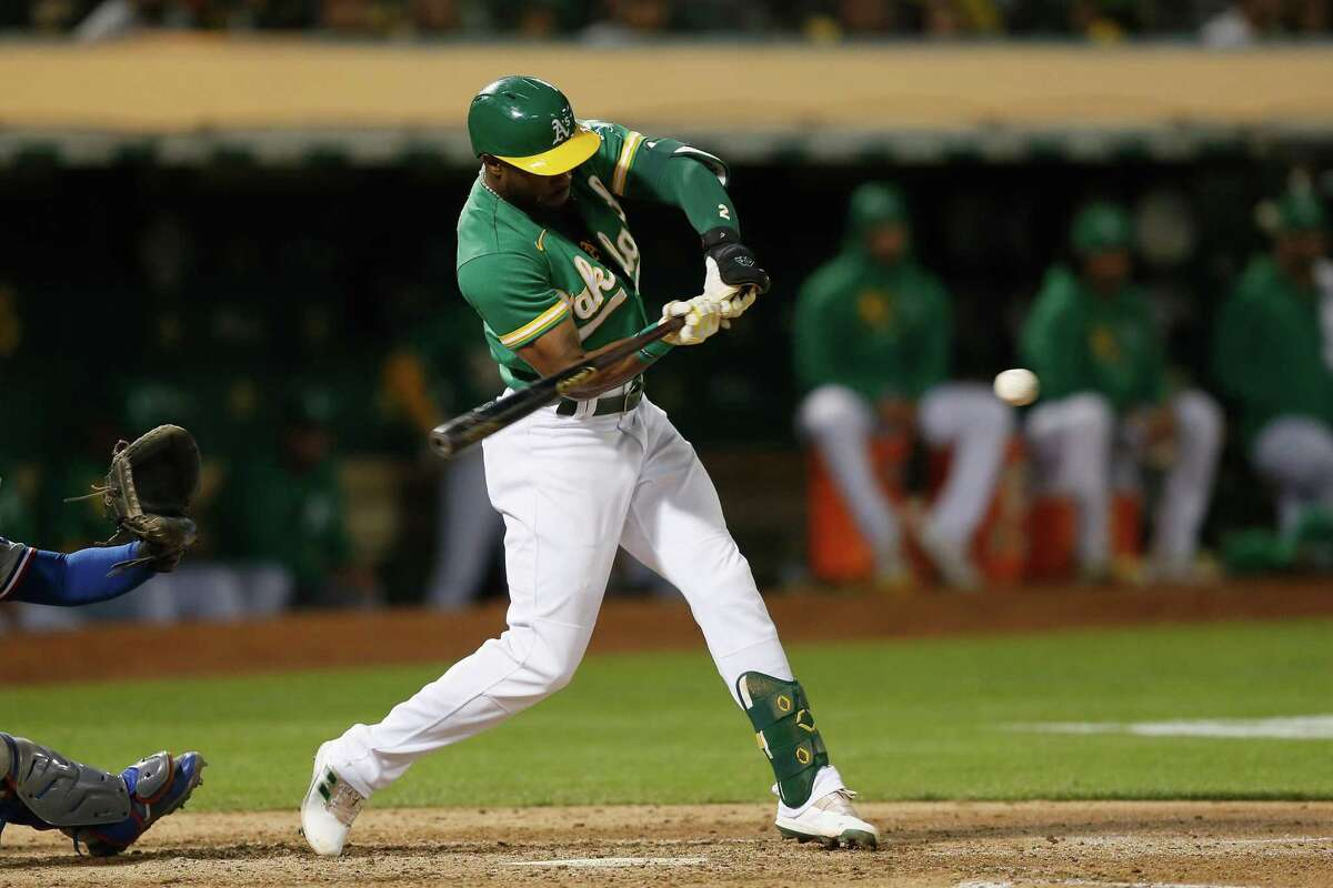 OAKLAND, CALIFORNIA - SEPTEMBER 10: Starling Marte #2 of the Oakland Athletics hits an RBI triple in the bottom of the fourth inning against the Texas Rangers at RingCentral Coliseum on September 10, 2021 in Oakland, California. (Photo by Lachlan Cunningham/Getty Images)