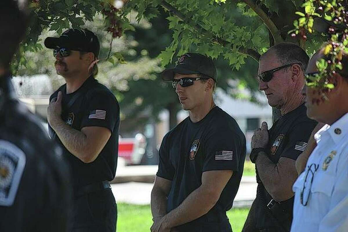Jacksonville firefighters attend the Sept. 11 remembrance ceremony on Thursday on the Jacksonville square.