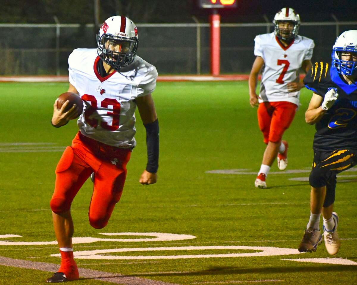 Lockney's Elias Alvarez gains big yardage on a run play during a non-district football game against Boys Ranch on Friday at Mitchel Zimmerman Field at Lockney. Alvarez's return to the field sparked the Longhorns to a 31-14 victory.