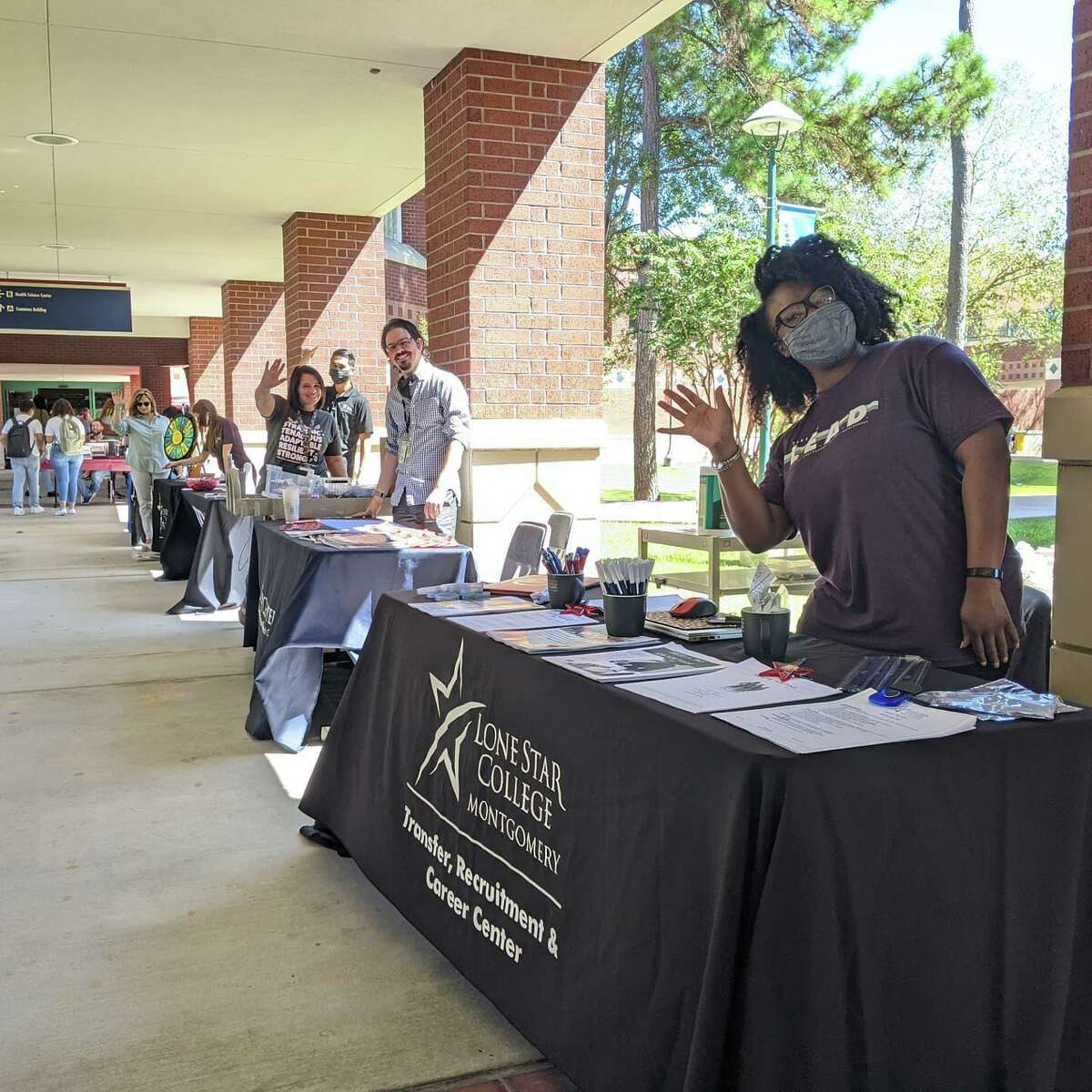 Lone Star College-Montgomery staff welcome students back to campus.