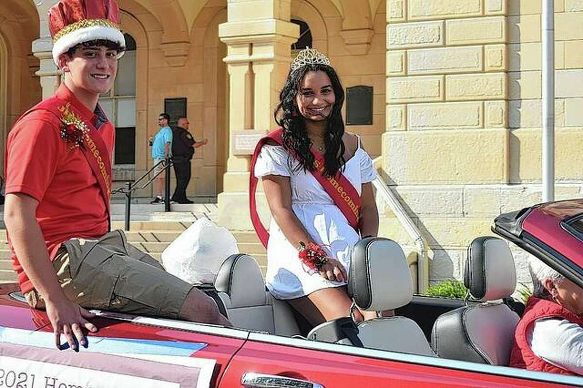 Jacksonville High School homecoming king Matthew Machino and queen Mya Lonergan greet the crowd during Friday's homecoming parade.