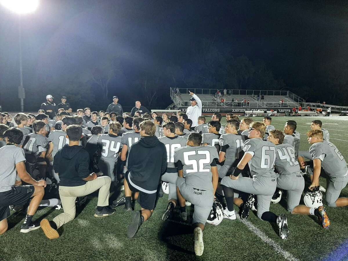 Xavier coach Andy Guyon addresses the Falcons after their 31-19 win over NFA Friday.