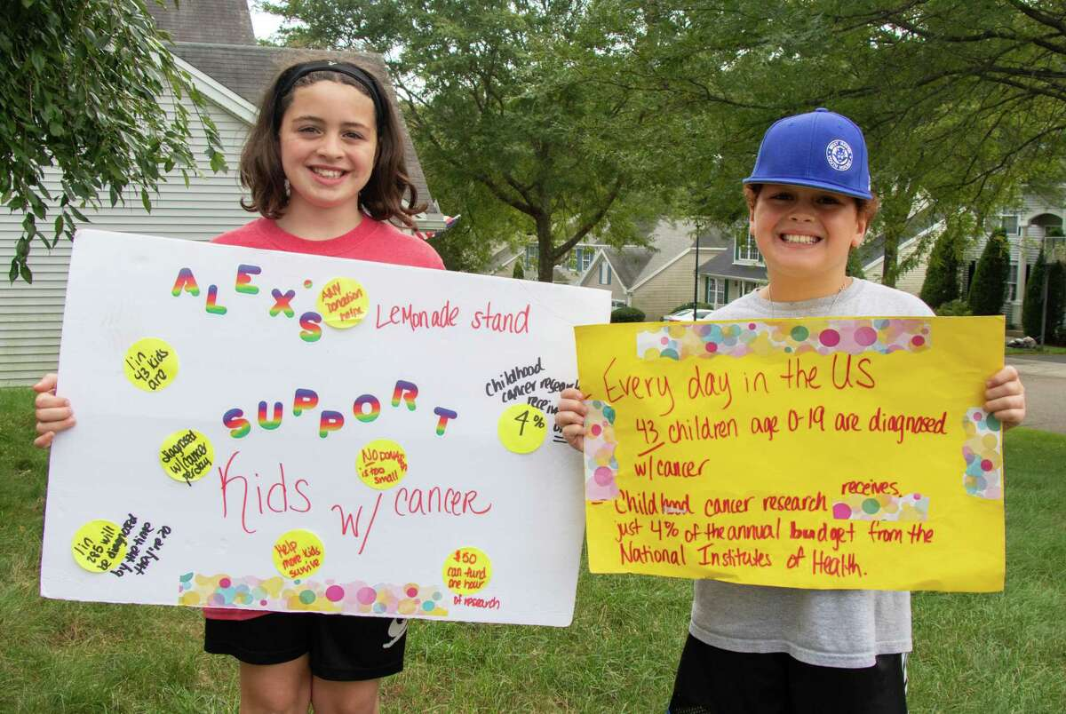 Brooklyn Farrell (left) and AJ Farrell, raise $1,325 for Alex's Lemonade Stand Foundation for Childhood Cancer during their Lemonade stand on Monday, Sept. 6.
