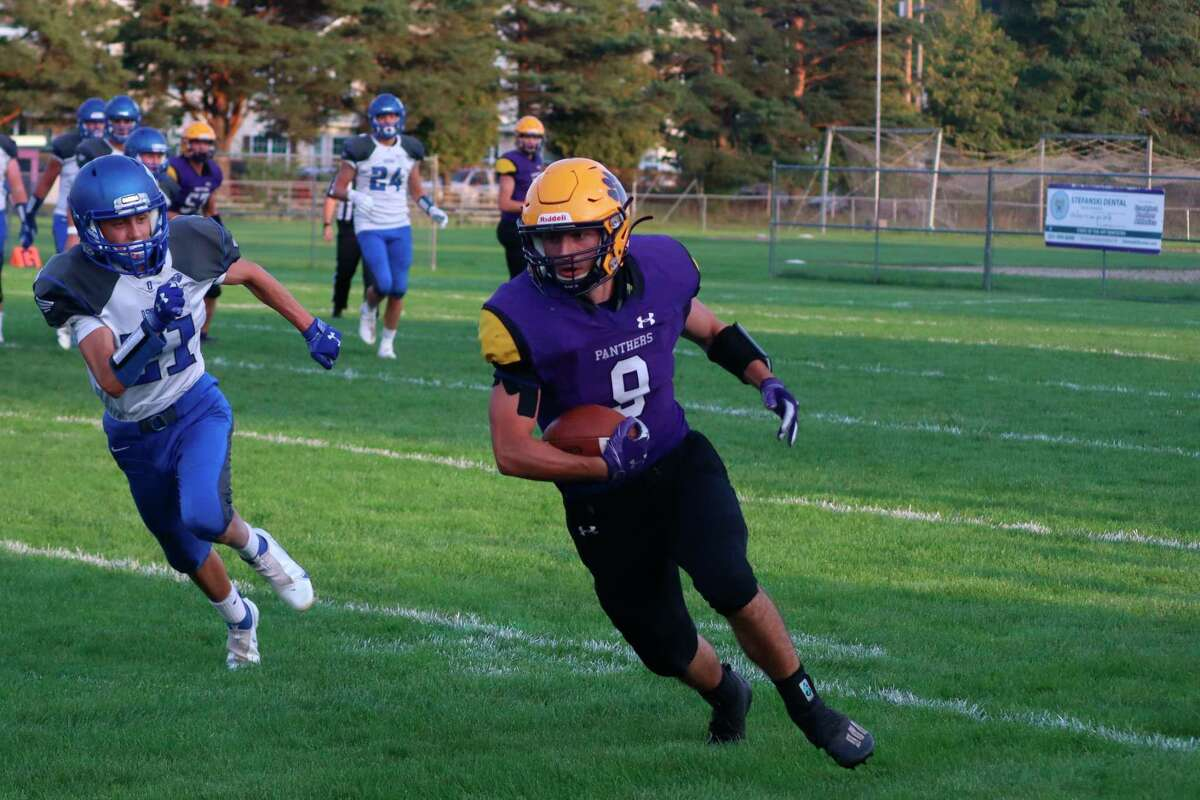 Camryn Lewis carries the ball for the Panthers during their win over Oscoda on Sept. 10. (Robert Myers/Record Patriot)