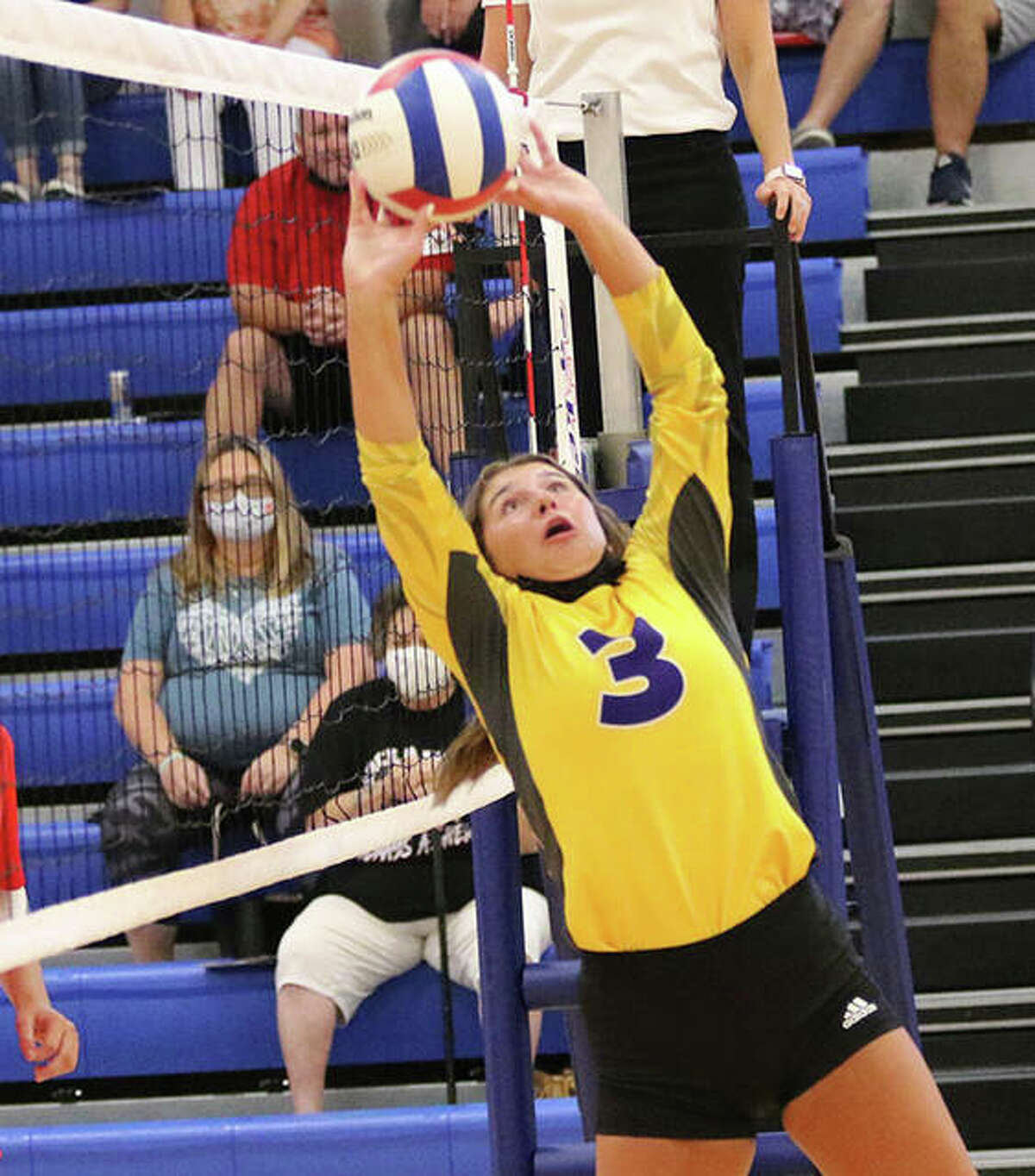 CM's Maddie Brueckner, shown staying off the net while making an off-balance set in the Roxana Tourney last month, had eight aces and 29 assists in the Eagles' two victories Friday at the Alton Tourney.