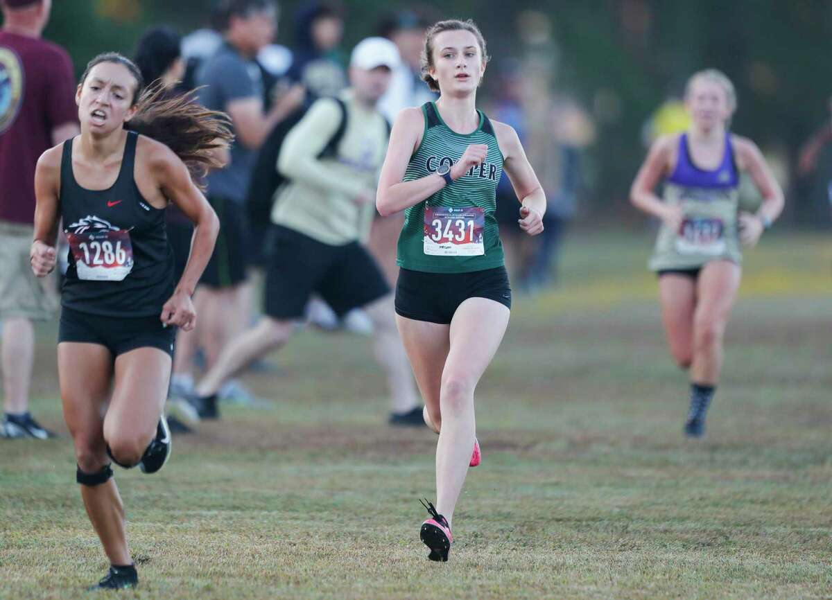 John Cooper's Megan Day finished fifth in the Dog Pound cross country meet at Magnolia High School, Saturday, Sept. 11, 2021, in Magnolia.