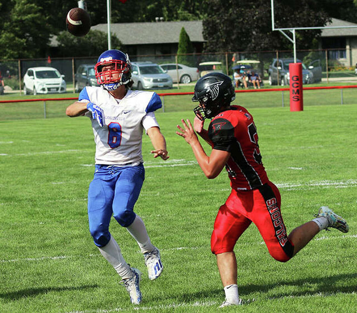 Carlinville quarterback Ayden Tiburzi (8) shown throwing under pressure from a Gibson City defender in a Week 1 game at Gibson City, threw a career-high five touchdown passes Friday night in the Cavs' win over Hillsboro in Carlinville.