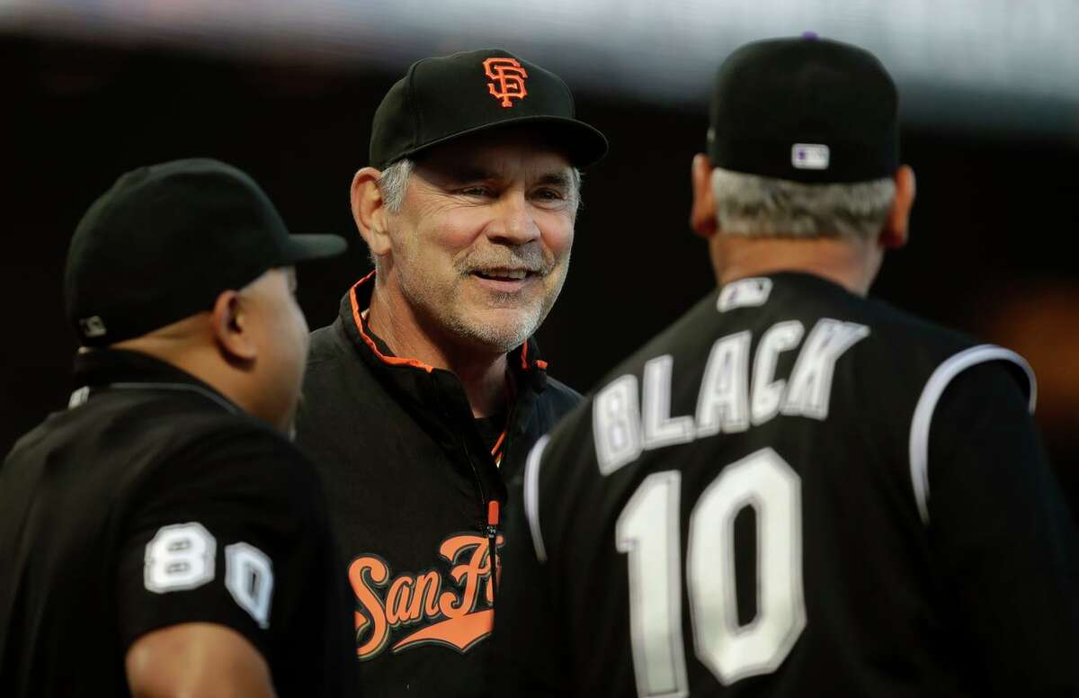 Then-Giants manager Bruce Bochy (center) speaks to Rockies skipper Bud Black (10) before a game in 2019 in San Francisco. Bochy retired from managing after a decorated 25-year career.