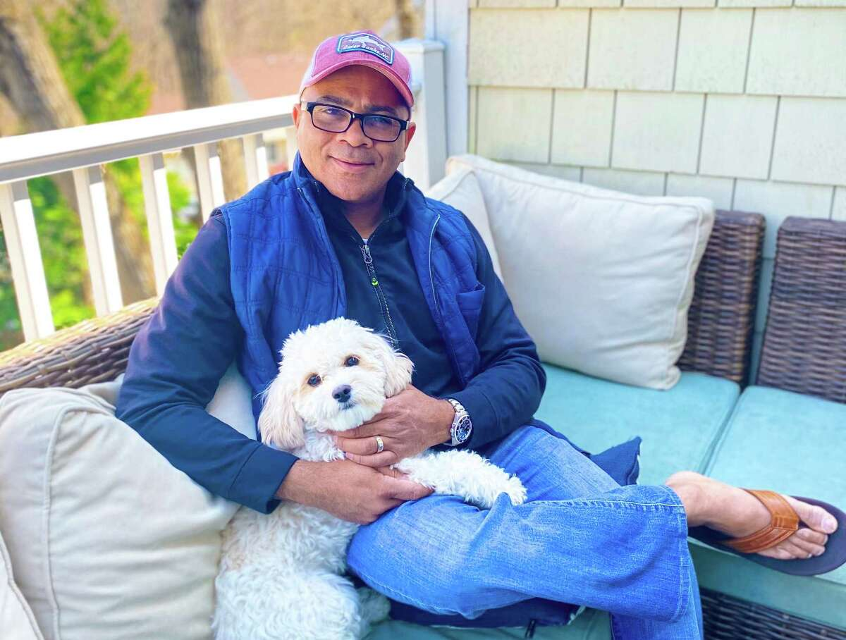 Zoundz for Pets founder Derrick Garrett with the family dog Miles Davis, at his Greenwich home.