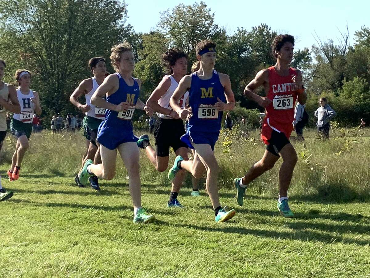 Midland High's Aiden Porritt (591) and Jacob Rudisel (596) compete at Saturday's Northwood Invitational cross country on the campus of Northwood University, Sept. 11, 2021.