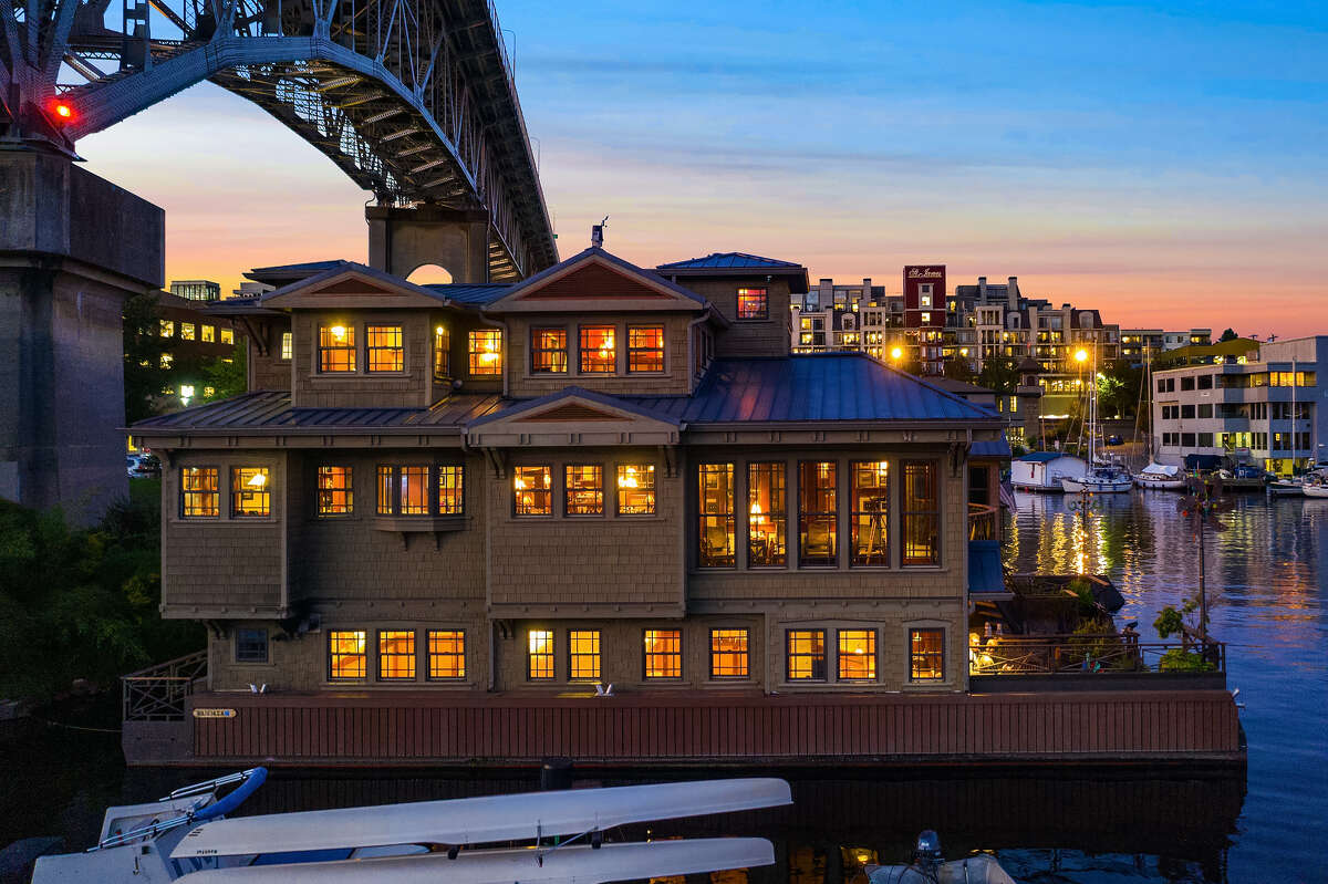 At night, lit up from every window, the houseboat appears like a jewel box set below the bridge.