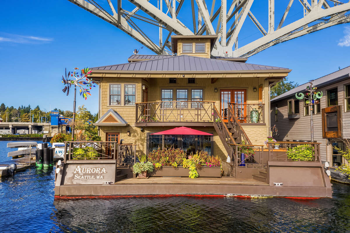 The Aurora has a patio and a deck as well as myriad widows for taking in its Lake Union setting.