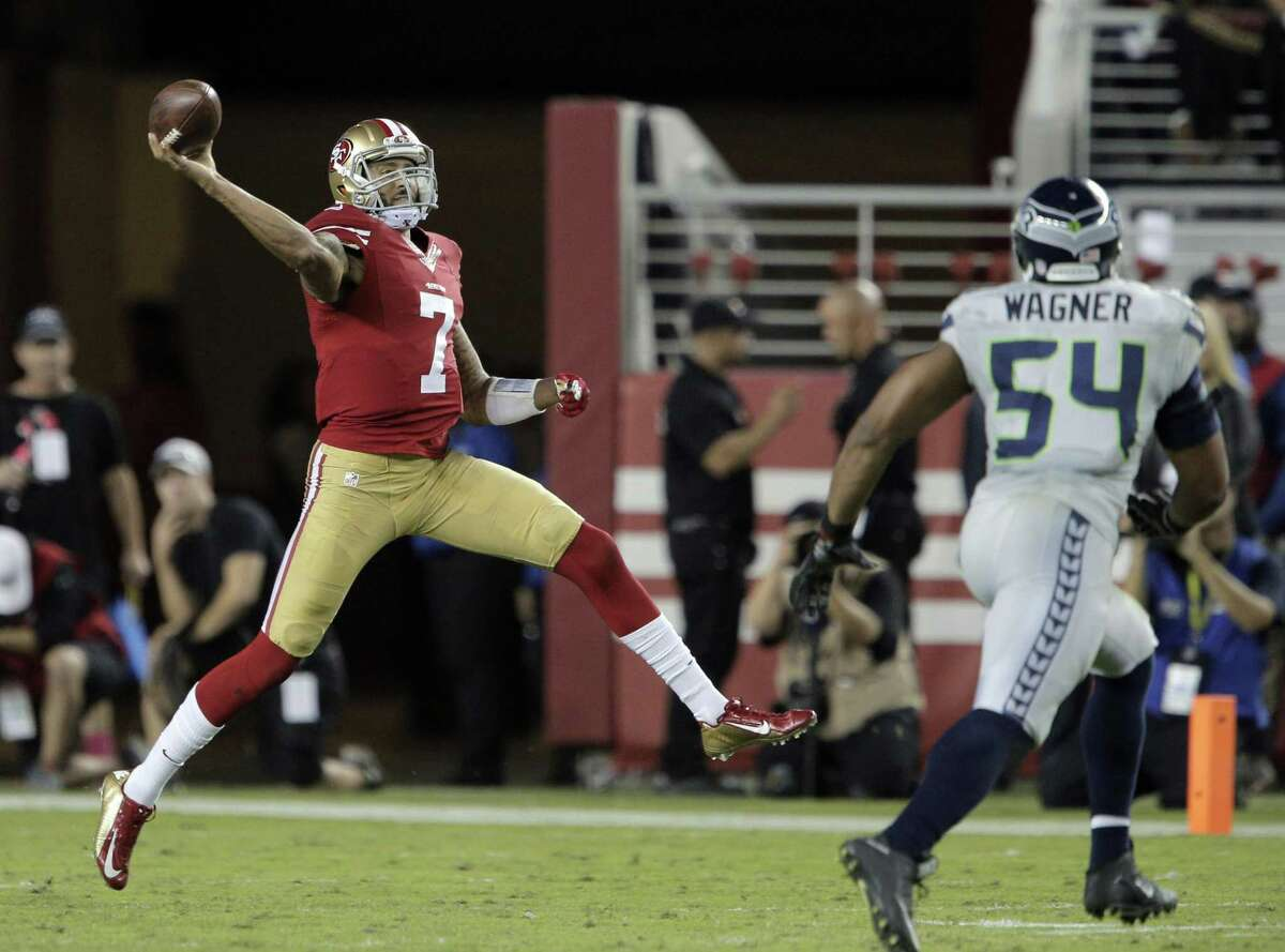 Colin Kaepernick (7) throws a pass to Quinton Patton (11) on the run in the second half of the 49ers game against the Seattle Seahawks at Levi's Stadium in Santa Clara, Calif., on Thursday, October 22, 2015.
