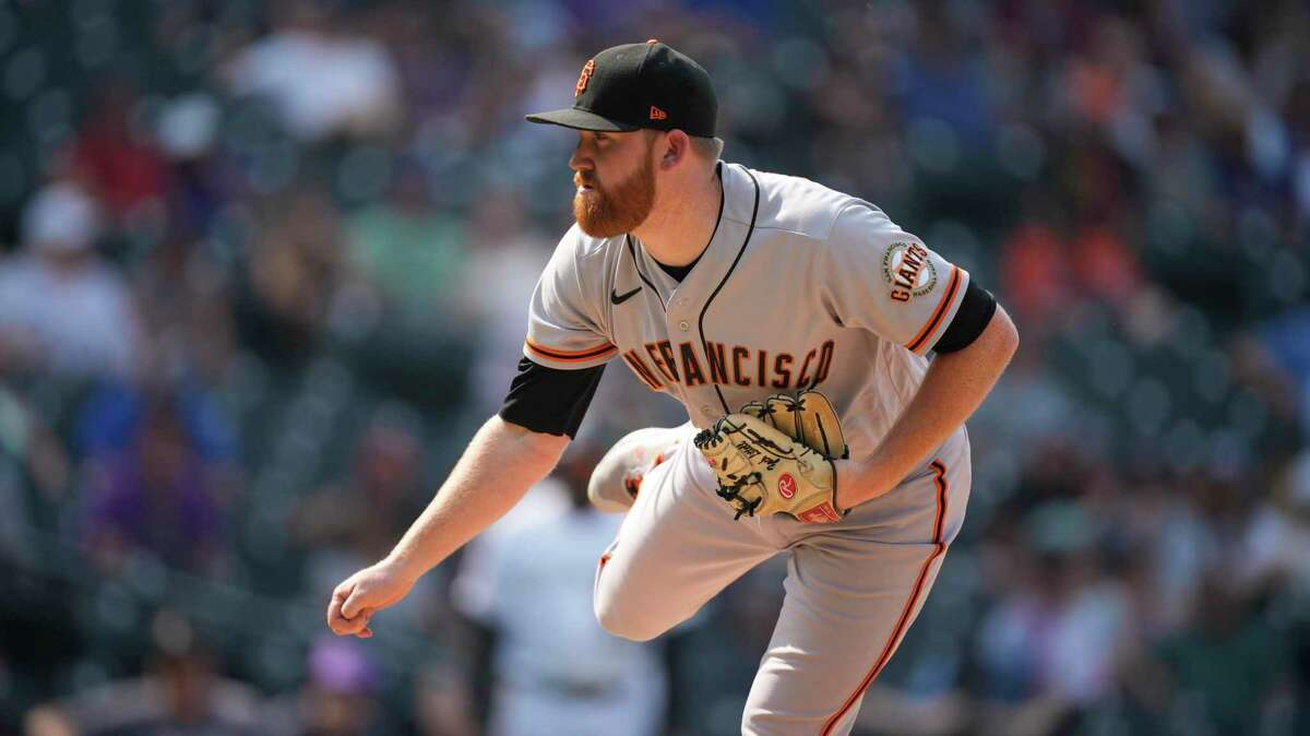San Francisco Giants relief pitcher Zack Littell (46) in the sixth inning of a baseball game Wednesday, Sept. 8, 2021, in Denver. (AP Photo/David Zalubowski)