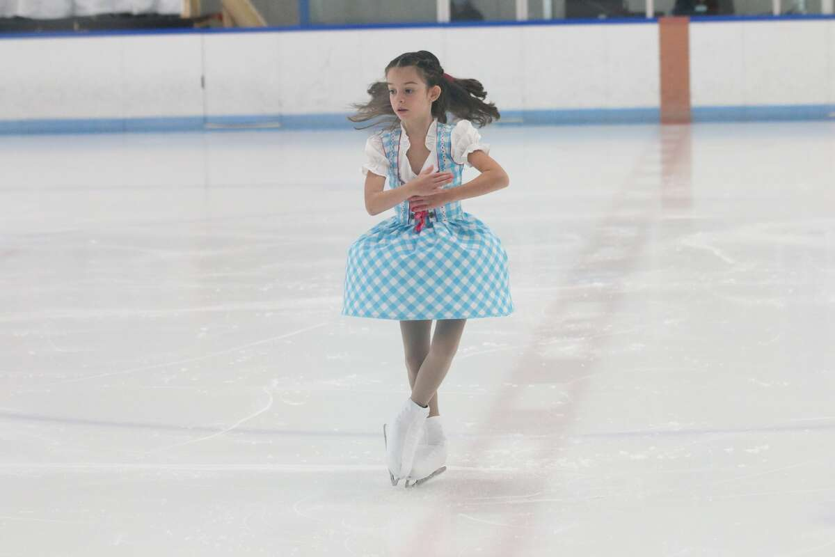 The Midland Figure Skating Club's Addisyn DiMuro competes in the Onyx Ice Challenge in Rochester Hills, Aug. 20-21, 2021.
