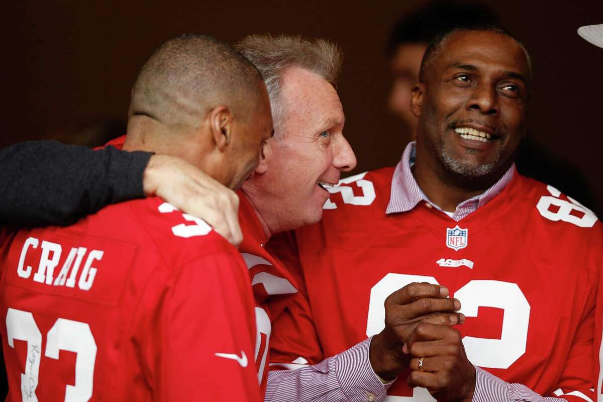 SANTA CLARA, CA - DECEMBER 20: (L-R) Former San Francisco 49ers players Roger Craig, Joe Montana and John Taylor are seen during a ceremony honoring the 1981-82 team at halftime of the NFL game between the San Francisco 49ers and the Cincinnati Bengals at Levi's Stadium on December 20, 2015 in Santa Clara, California. (Photo by Ezra Shaw/Getty Images)