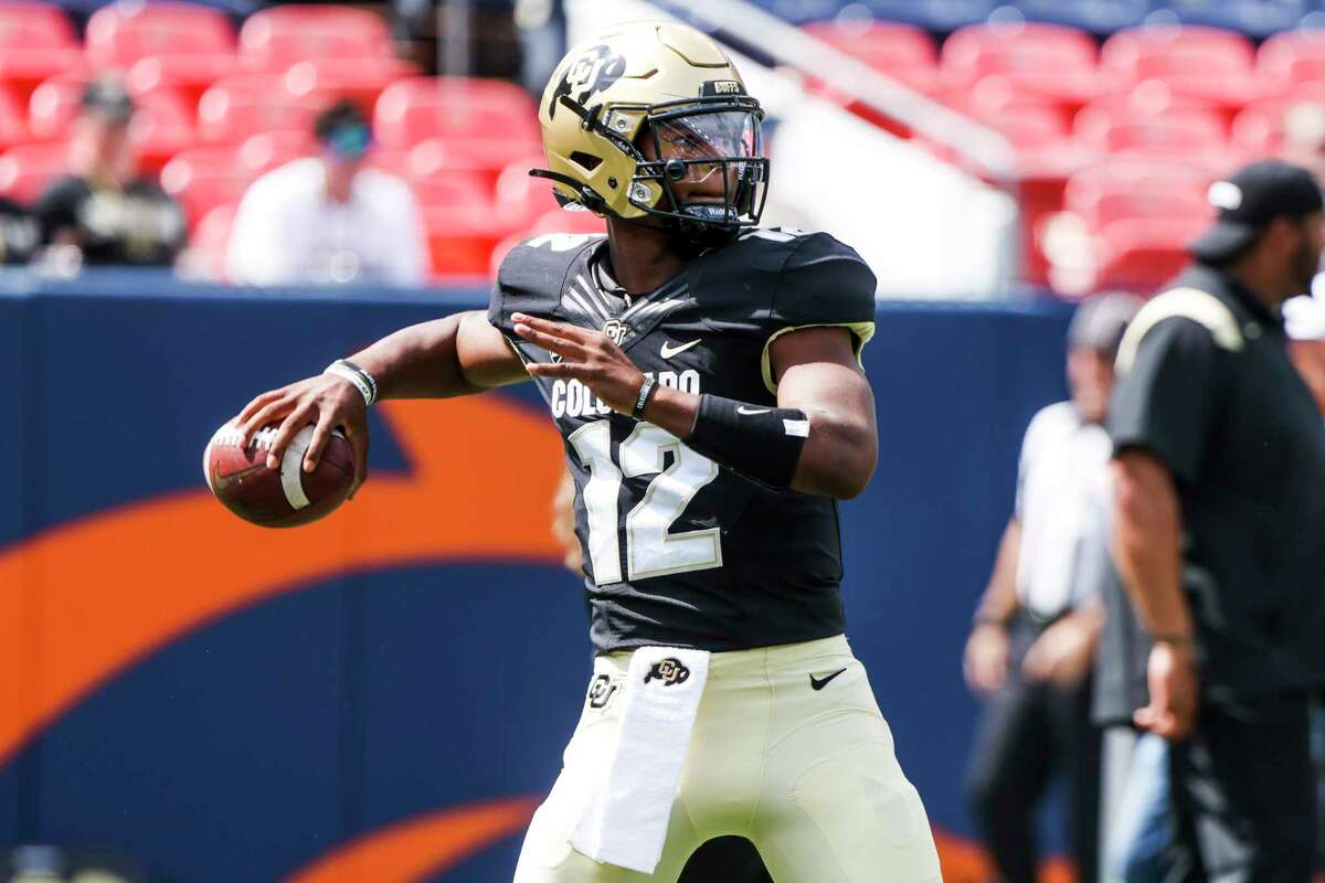 DENVER, CO - SEPTEMBER 11: Brendon Lewis #12 of the Colorado Buffaloes warms up before playing the Texas A&M Aggies at Empower Field At Mile High on September 11, 2021 in Denver, Colorado.