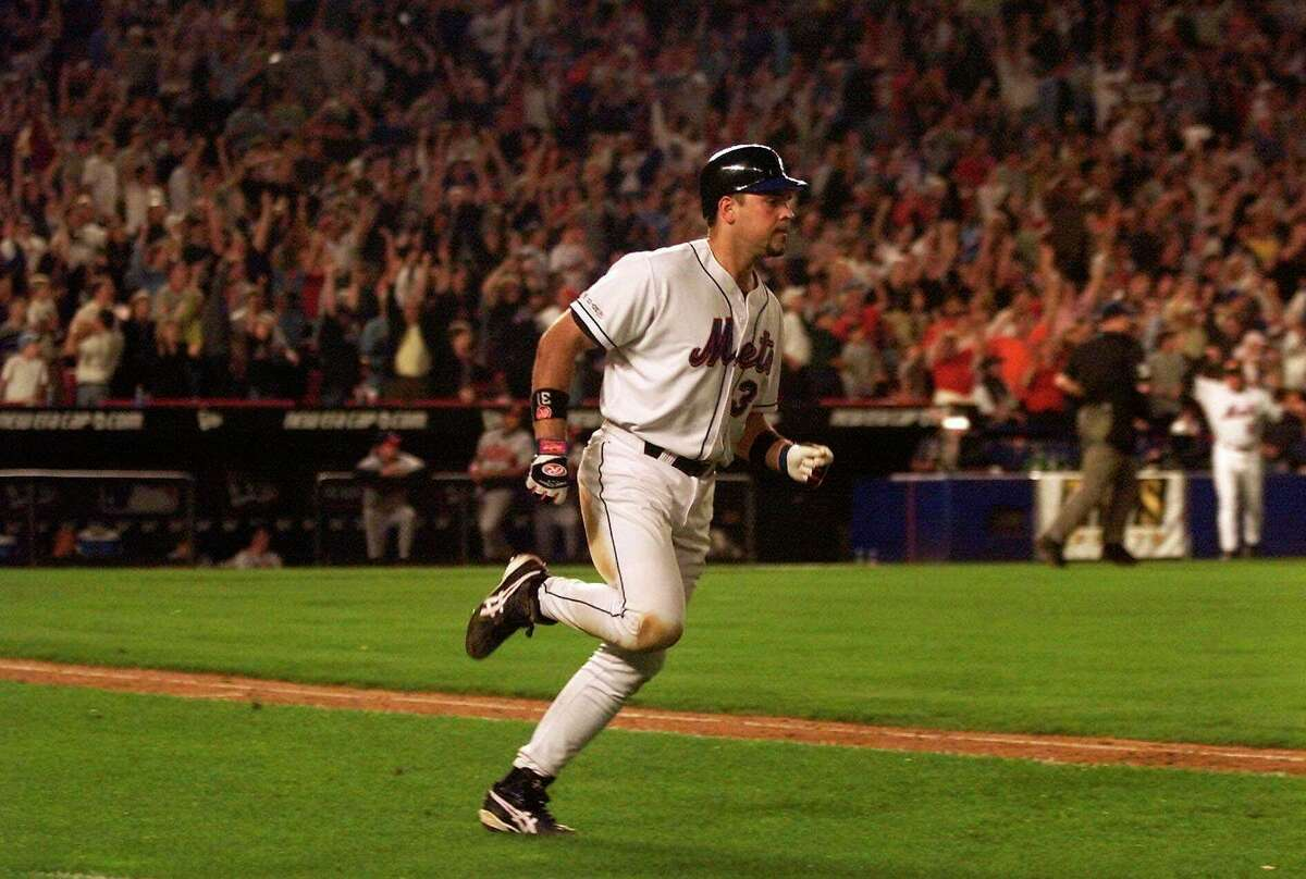 In this Sept. 21, 2001, photo, New York Mets Mike Piazza rounds the bases on hitting a two-run home run in the eighth inning of a baseball game against the Atlanta Braves at Shea Stadium in New York.