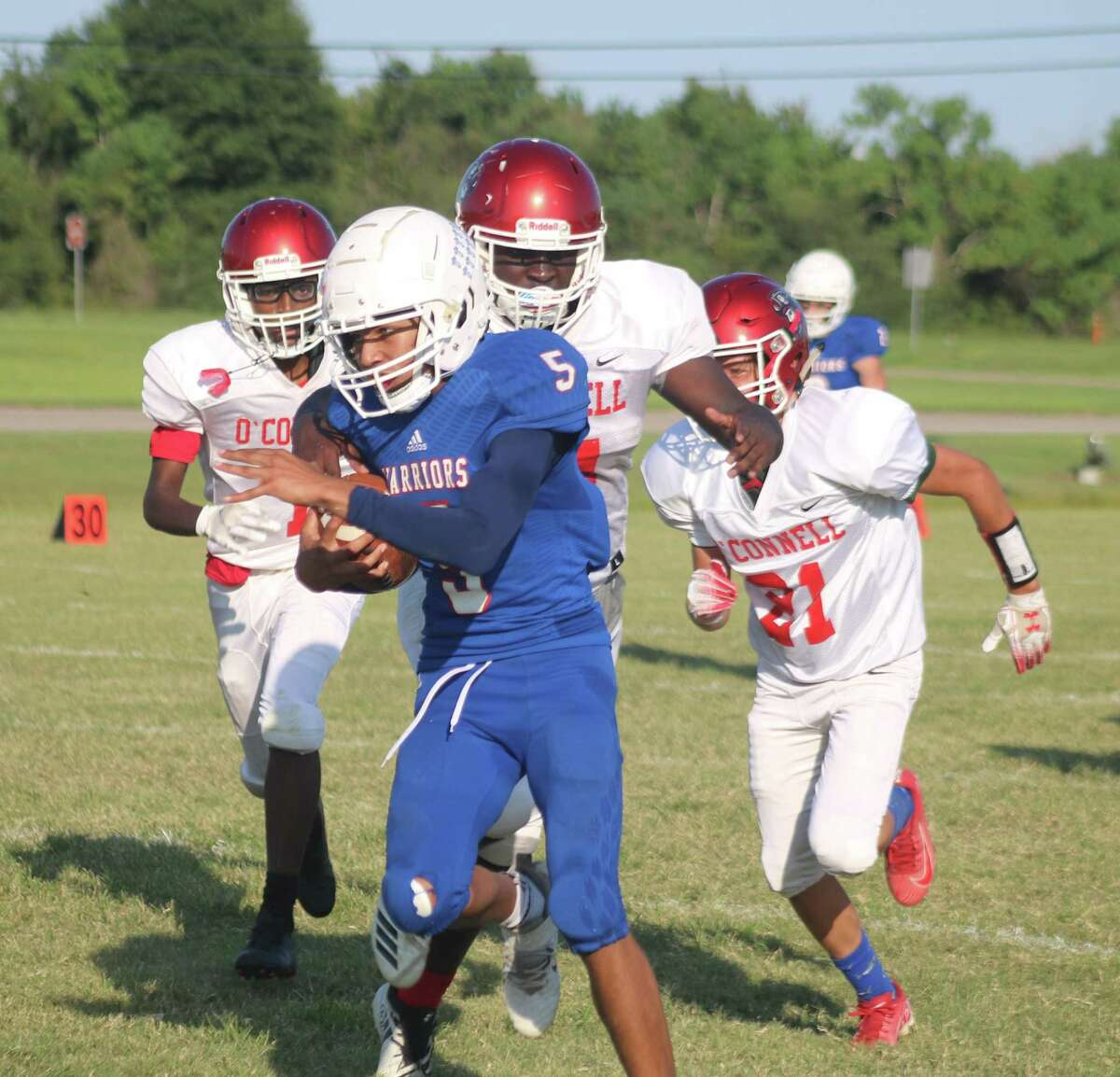 Donald Guillory collects more of his big yardage during Friday night's 72-25 win over Galveston O'Connell.