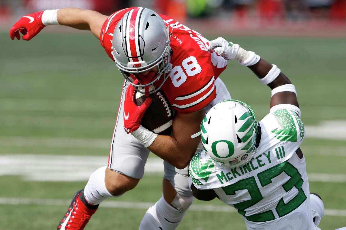 Oregon defensive back Verone McKinley, right, tackles Ohio State tight end Jeremy Ruckert during the second half of an NCAA college football game Saturday, Sept. 11, 2021, in Columbus, Ohio. Oregon beat Ohio State 35-28. (AP Photo/Jay LaPrete)