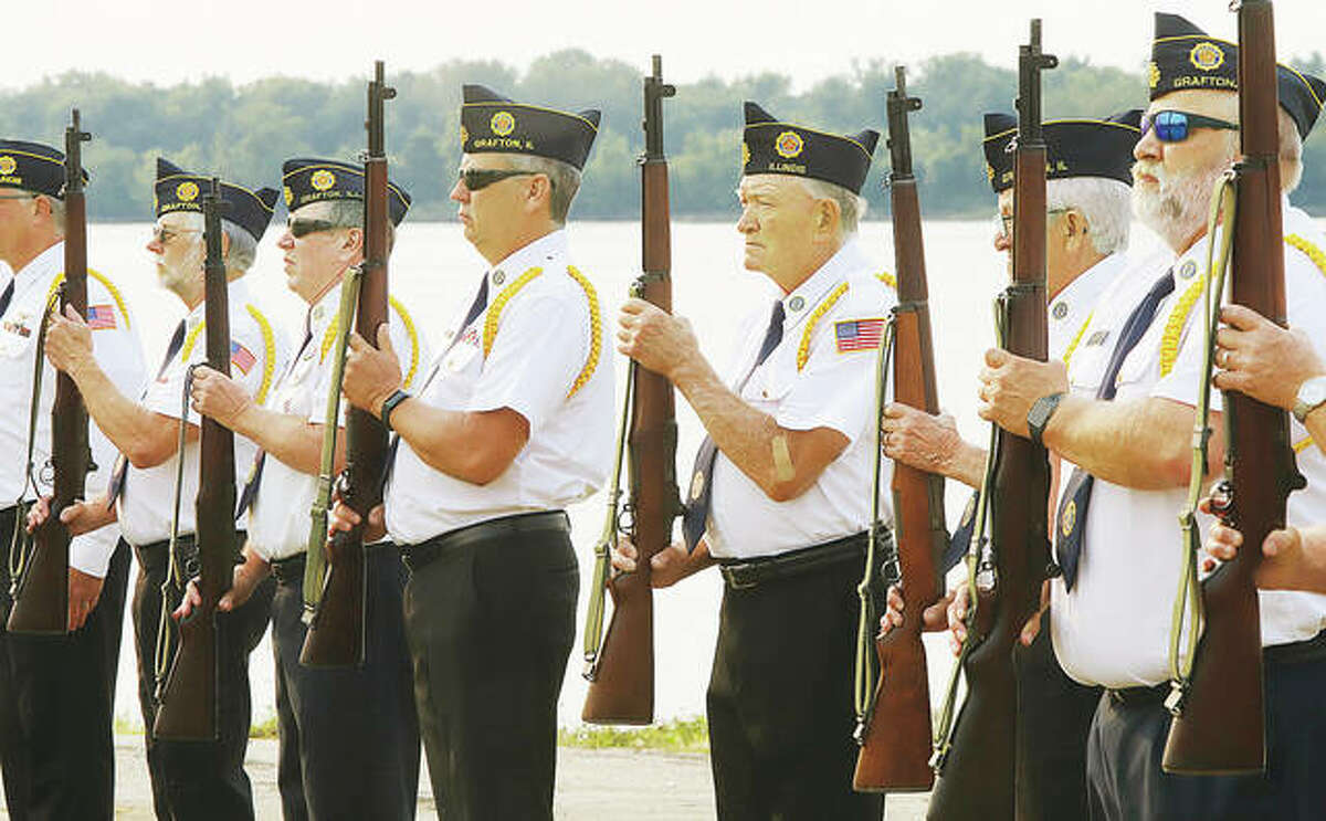Members of the Grafton VFW Post 648 honor guard prepare to fire a rifle tribute Saturday at the September 11 anniversary rememberance on the Grafton riverfront. The solemn ceremony marked the 20th anniversary of the event and remembered the thousands of people who lost their lives in the terrorist attacks on America that day. Additional photos from the event are online at thetelegraph.com. - John Badman|The Telegraph