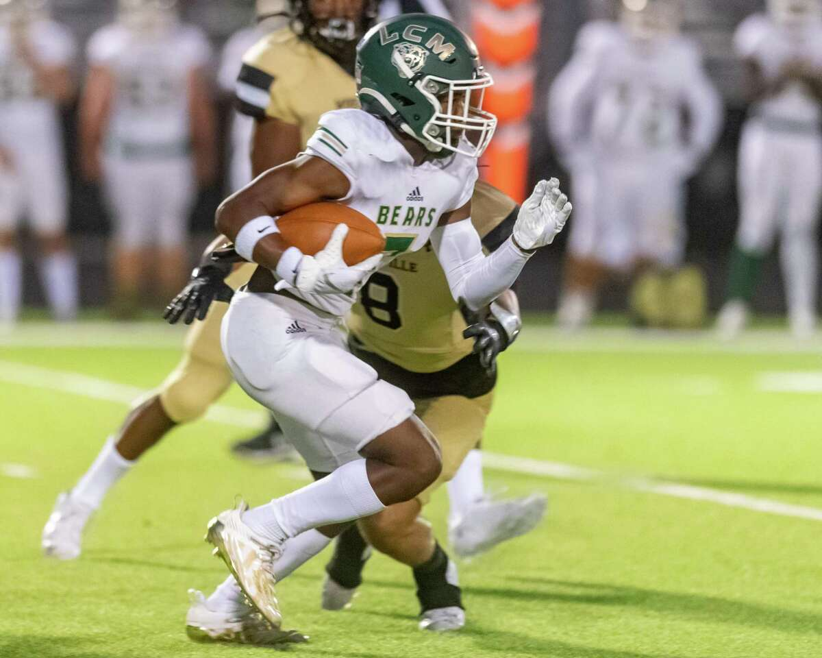 LCM's Da'Marion Morris (7) carries the all upfield in the first half. The Woodville Eagles and the Little Cypress-Mauriceville Bears faced off on Friday night in Woodville with a final score of 14-6 with the home team taking the victory. Photo made on September 18, 2020. Fran Ruchalski/The Enterprise