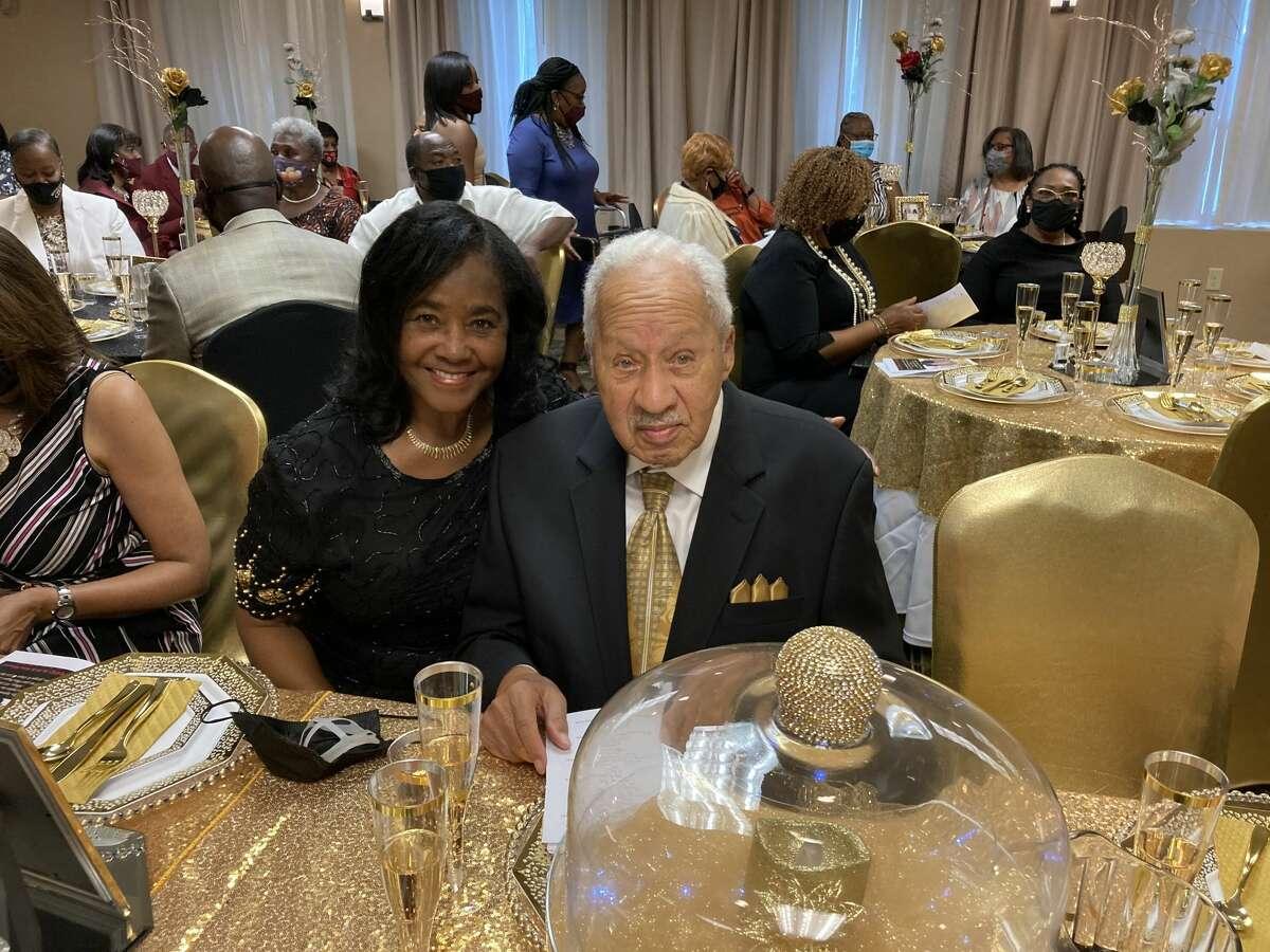 Rev. Robert Dixon, former pastor of Mount Calvary Baptist Church, right, and his wife Georgia Dixon, celebrate his 100th birthday Saturday.