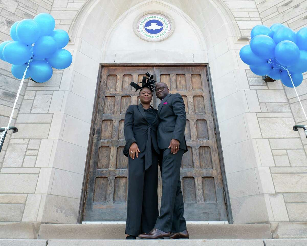 Pastors Lanre and Abiola Peters stand outside the Redeemed Christian Church of God at 475 State St. in Albany, NY. The congregation, which is active in the community and had been worshiping on Lexington Avenue, held a grand opening for its recently purchased sanctuary on Saturday, Sept. 11, 2021. (Jim Franco/Special to the Times Union)