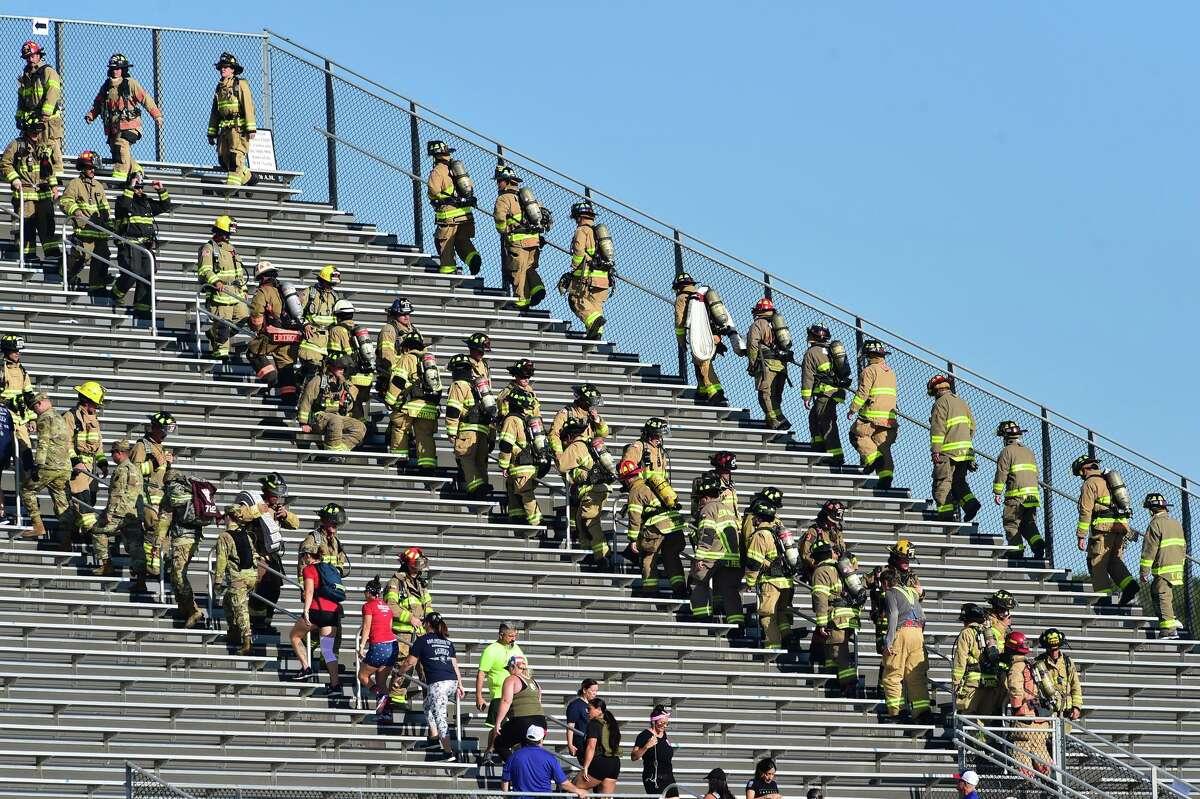 First responders climb the steps during San Antonio's 110 9/11 Memorial Climb on Saturday morning at Heroes Stadium.