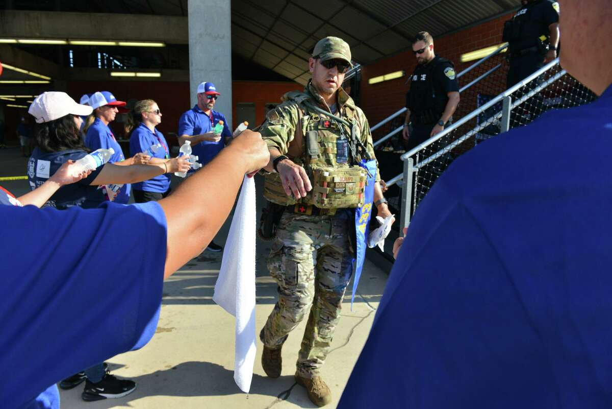 A first responder grabs a cold towel during San Antonio's 110 9/11 Memorial Climb on Saturday morning at Heroes Stadium.