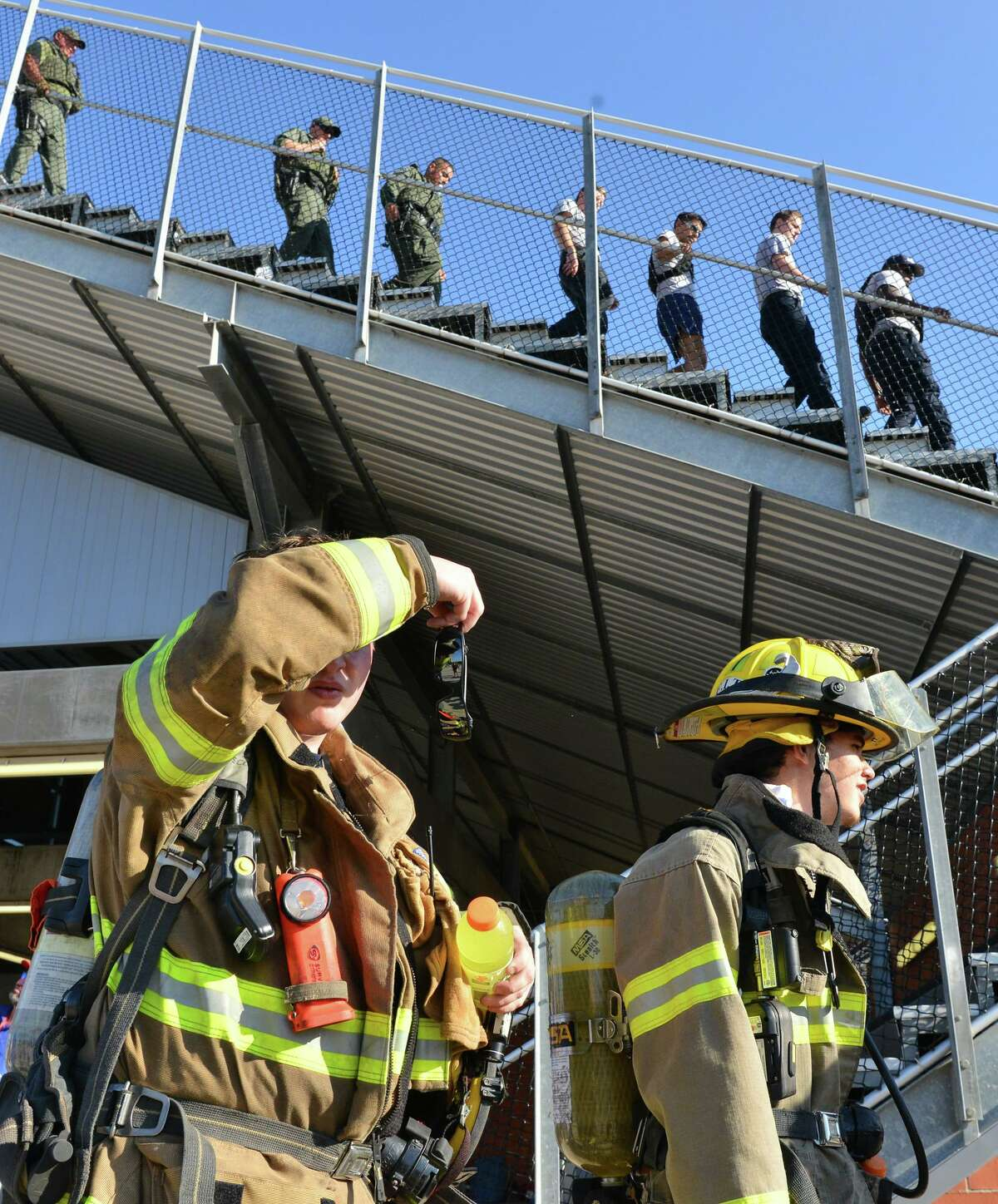 A first responder wipes sweat during San Antonio's 110 9/11 Memorial Climb on Saturday morning at Heroes Stadium.