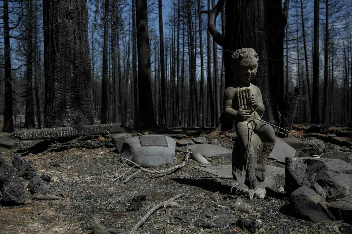 Headstones, some dating to the early 1800s, are charred at the Pioneer Cemetery in Grizzly Flats (El Dorado County). The town experienced a devastating loss of homes, its two-room schoolhouse, post office, church and firehouse after flames from the Caldor Fire ripped through the area last month.