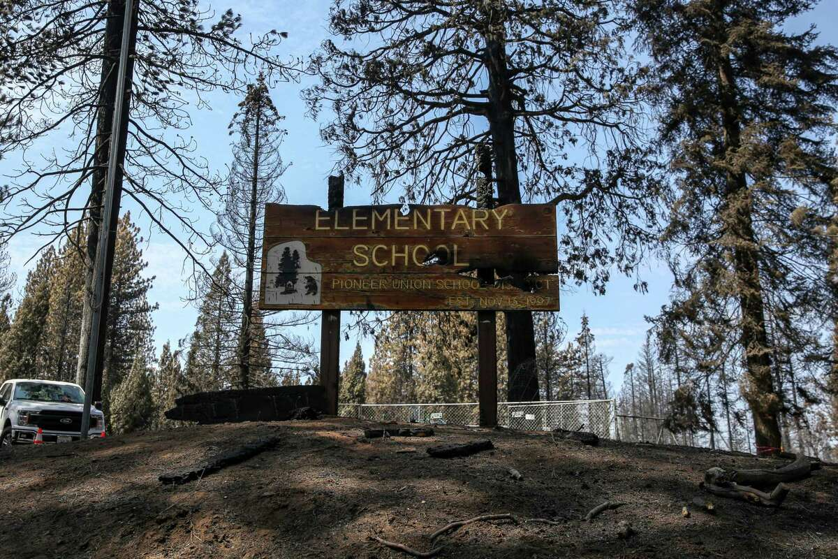 A burned school sign for Walt Tyler Elementary School in Grizzly Flats (El Dorado County). The destroyed two-room schoolhouse was named after a member of the Tyler family who have lived in the area for over a century.