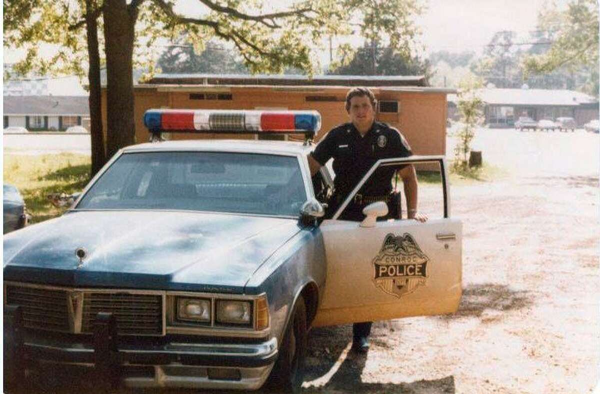 Conroe Police Officer William Grange McCreary is seen beside his patrol car in this photo from around 1979 or 1980.
