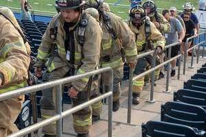 More than 400 area first responders, family members and members of the public walk the bleachers 09/11/2021 at Grande Communications Stadium, climbing the equivalent of 110 stories in remembrance of first responders that gave their life, as well as civilians who died in the Sept, 11 2001 terror attacks. Tim Fischer/Reporter-Telegram