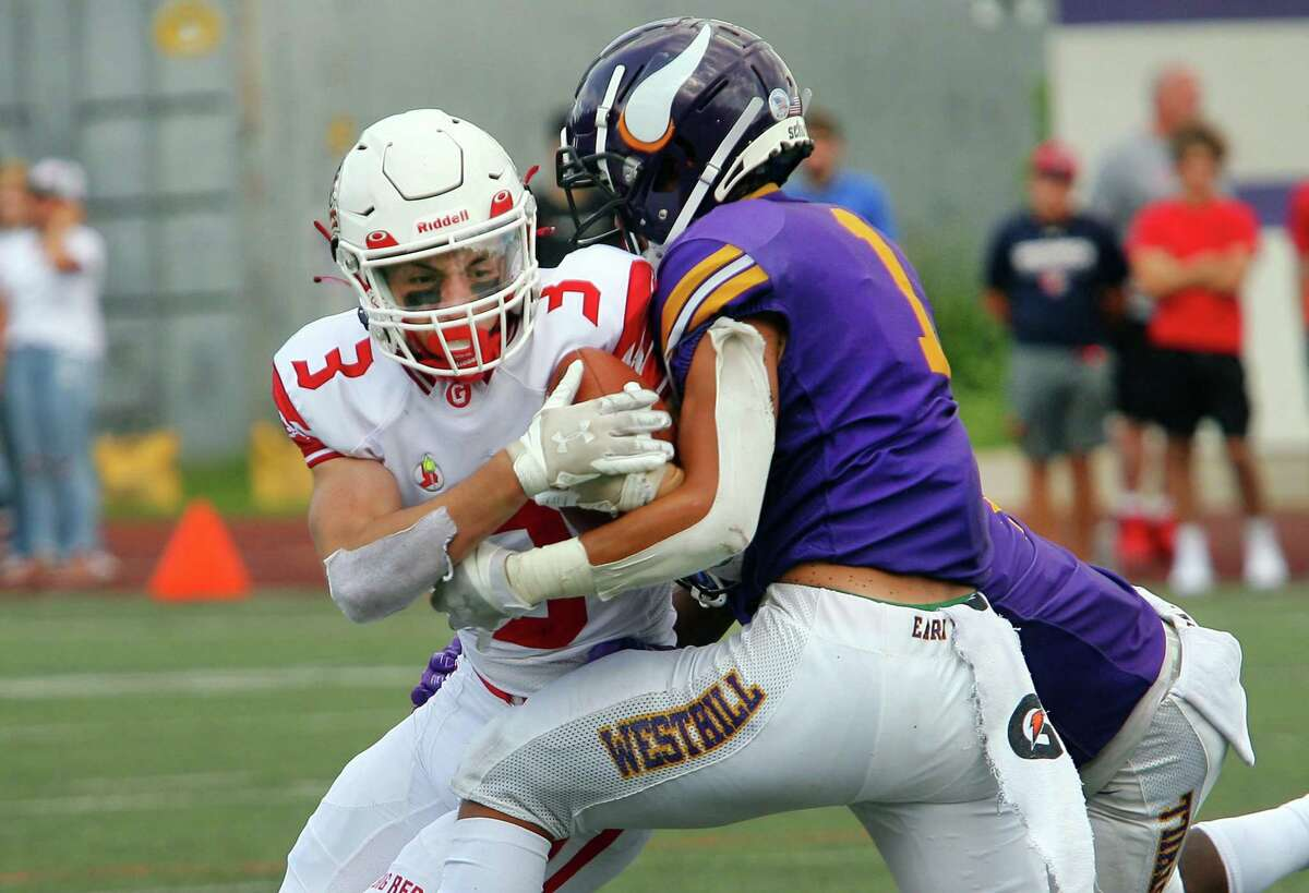 Greenwich's Zach Mantione is tackled by Westhill's Kevin Laba on Saturday in Stamford.