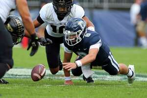 UConn quarterback Steven Krajewski (8) looks to recover a fumble during the first half against Purdue on Saturday in East Hartford.