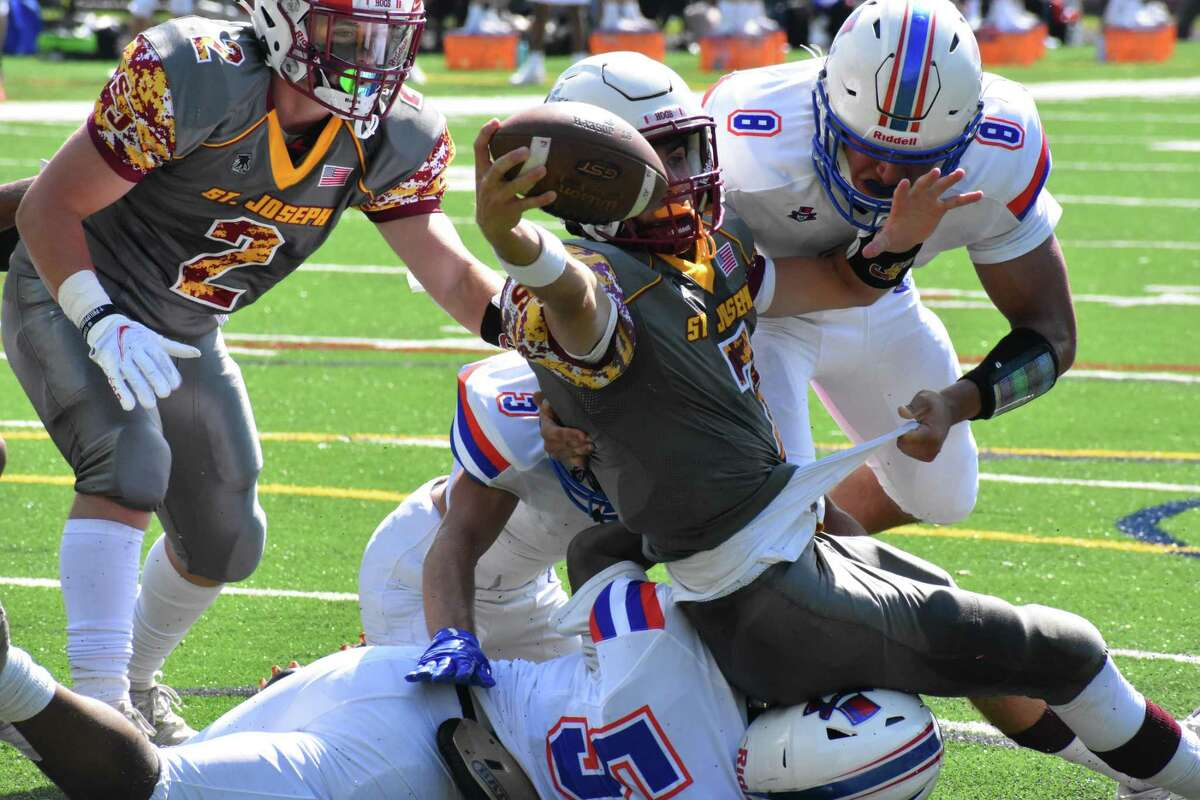 St. Joseph quarterback Matt Morrissey stretches out for the end zone during a football game between St. Joseph and Danbury at St. Joseph high school, Trumbull on Saturday, Sept. 11, 2021.