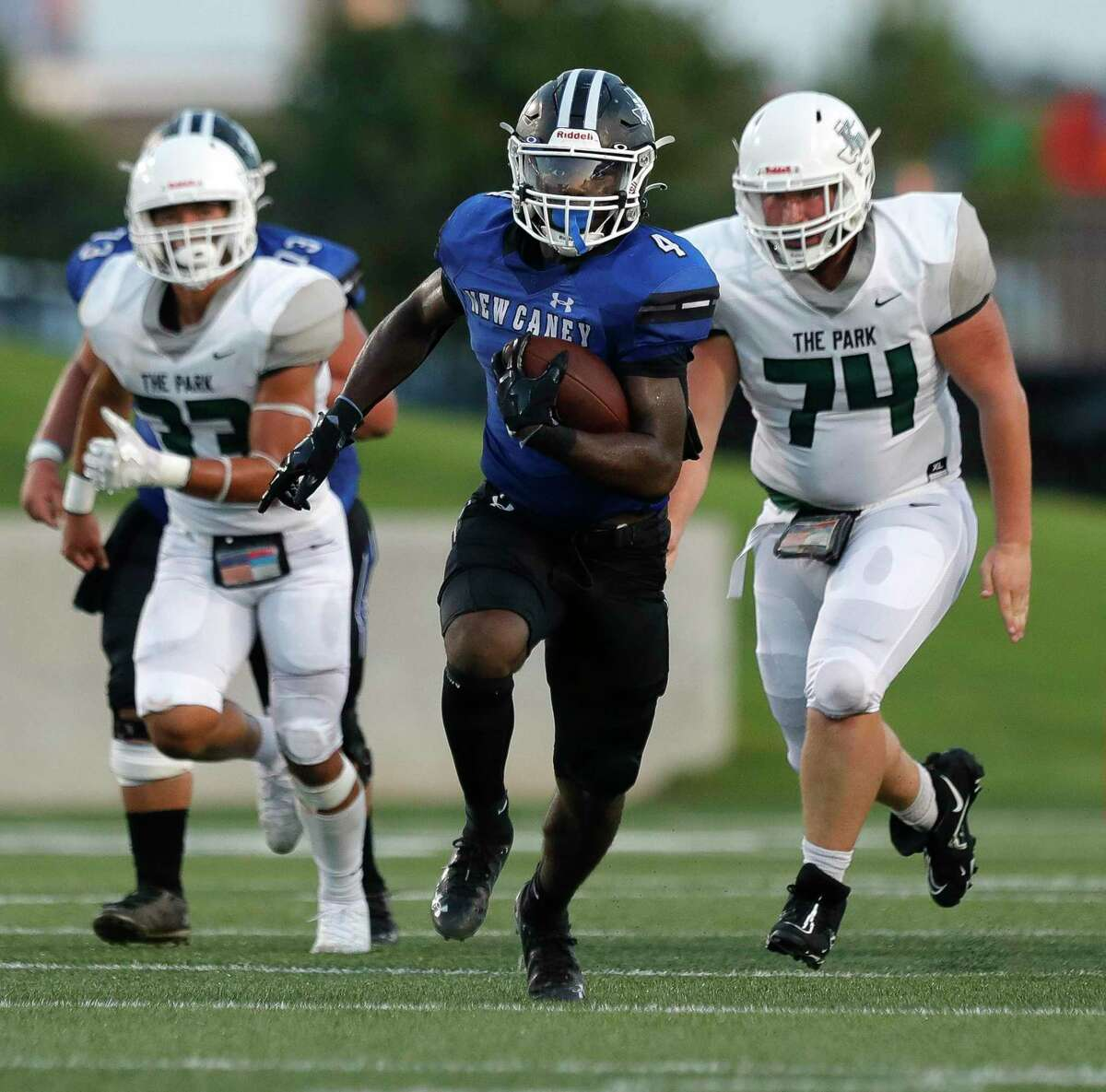 New Caney running back Arkez Gomez (4), shown here last week against Kingwood Park, had a 30-yard touchdown run against Porter Friday night.